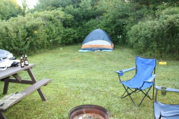 Photo of tent campsite with picnic table