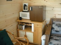 Table with mini-fridge, microwave, and coffee maker