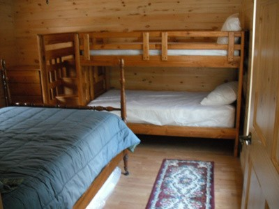 Bedroom with bunk beds and separate bed