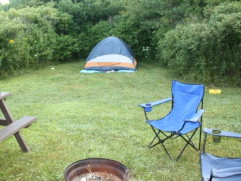 Tent campsite with picnic table