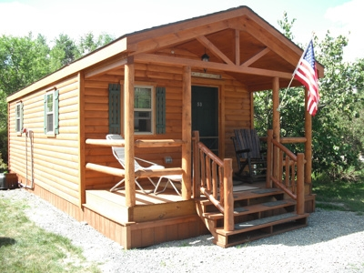 Log cabin with American flag outside