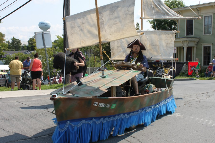 Man in pirate costume driving boat