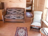 Inside of cabin with sofa and reclining chair